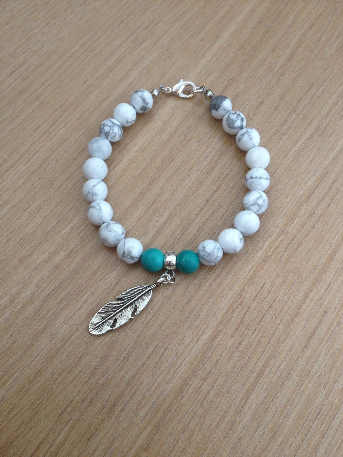 Boho beaded bracelet with howlite, turquoise and a feather charm, natural stone, handmade