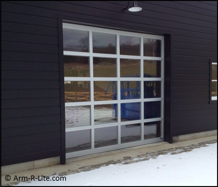 Artist Studio glass garage door with welded aluminum frame and clear glazing. Door by Arm & Artist Studio glass garage door with welded aluminum frame and clear ...