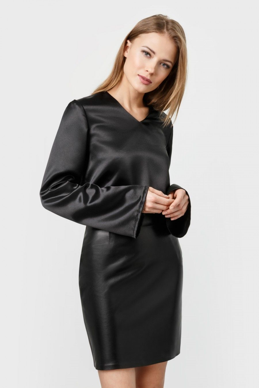 Black satin long-sleeved T-shirt blouse and leather skirt ...
