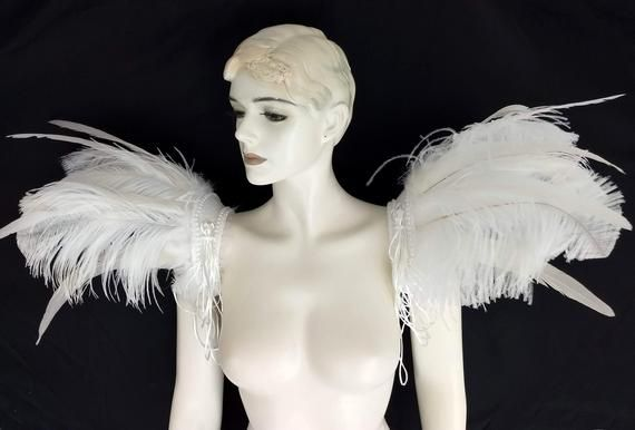 We make and ship our items really fast if you need it for a specific date please let us know. or call/text us at 954-3051817 to complete your order over the phoneFeather epaulettes  Feather Carnival Set Shoulder Pieces  showgirl carnival pageant epaulets Elton John Inspired This set is has larger feathers than our original Elton John set but the base is the same sizeWhite ostrich Feathers and cocktail feathers ( 1 pair)White backgroundPearl edge and cord details as shown on the life magazine cov