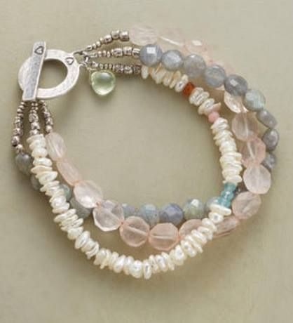 Act III Bracelet by Nicole Ardis Jewelry Our three-strand interplay of color and sheen features labradorites, rose quartz and cultured pearls, garnet, pink opal and apatite. Matte sterling silver toggle clasp.