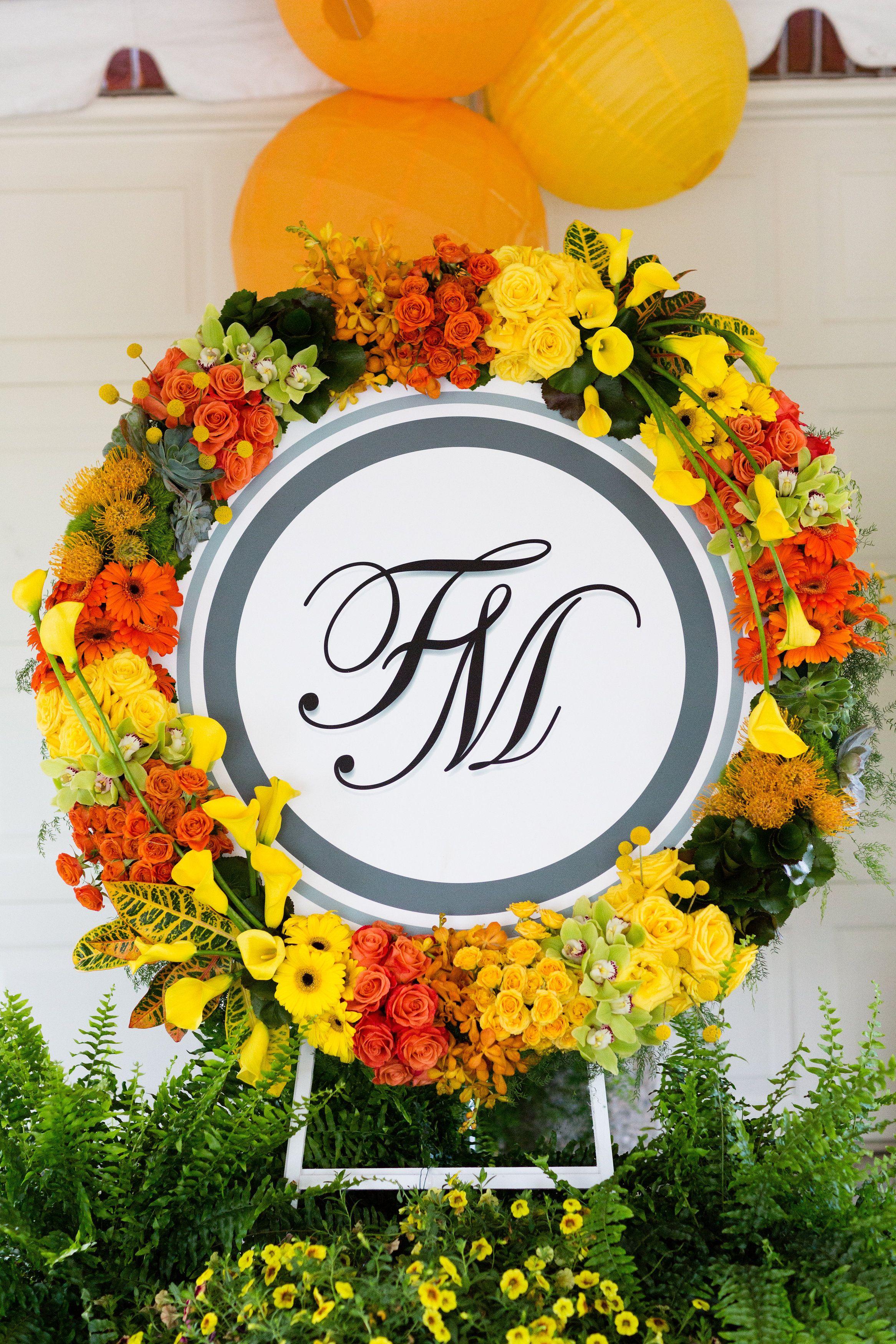 A stunning floral wreath surrounding their monogram