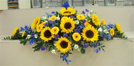 Sunflowers Delphiniums Long Low Top Table Arrangement From The Flower Shop Wedding Flower Arrangements Spring Wedding Flowers Wedding Flowers