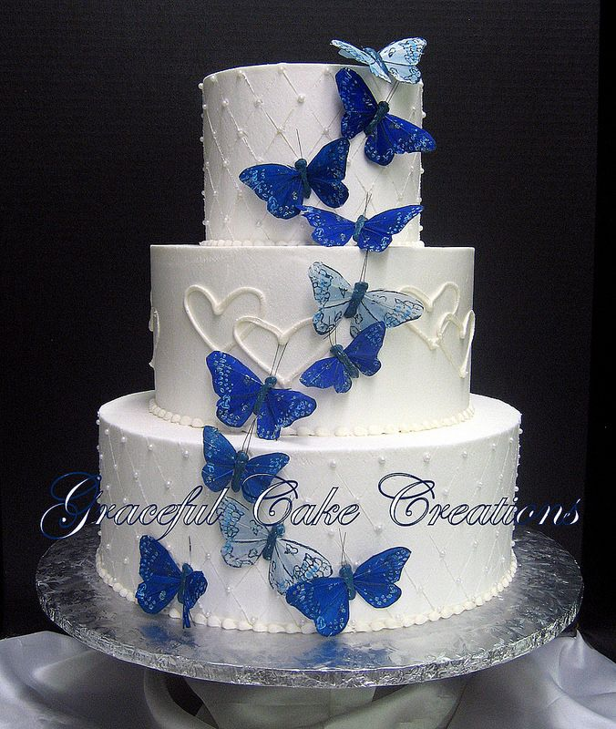 Elegant White Wedding Cake With Butterflies And Hearts