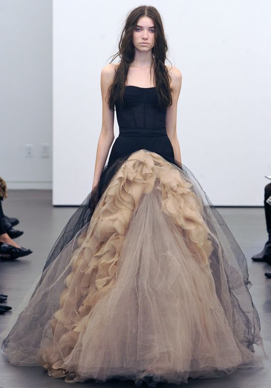 Vera Wang. Never have I even liked a wedding dress before I saw this one.... perfection