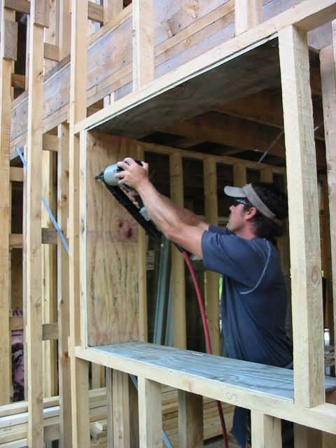 The 12-in.-deep window rough openings are lined with plywood.