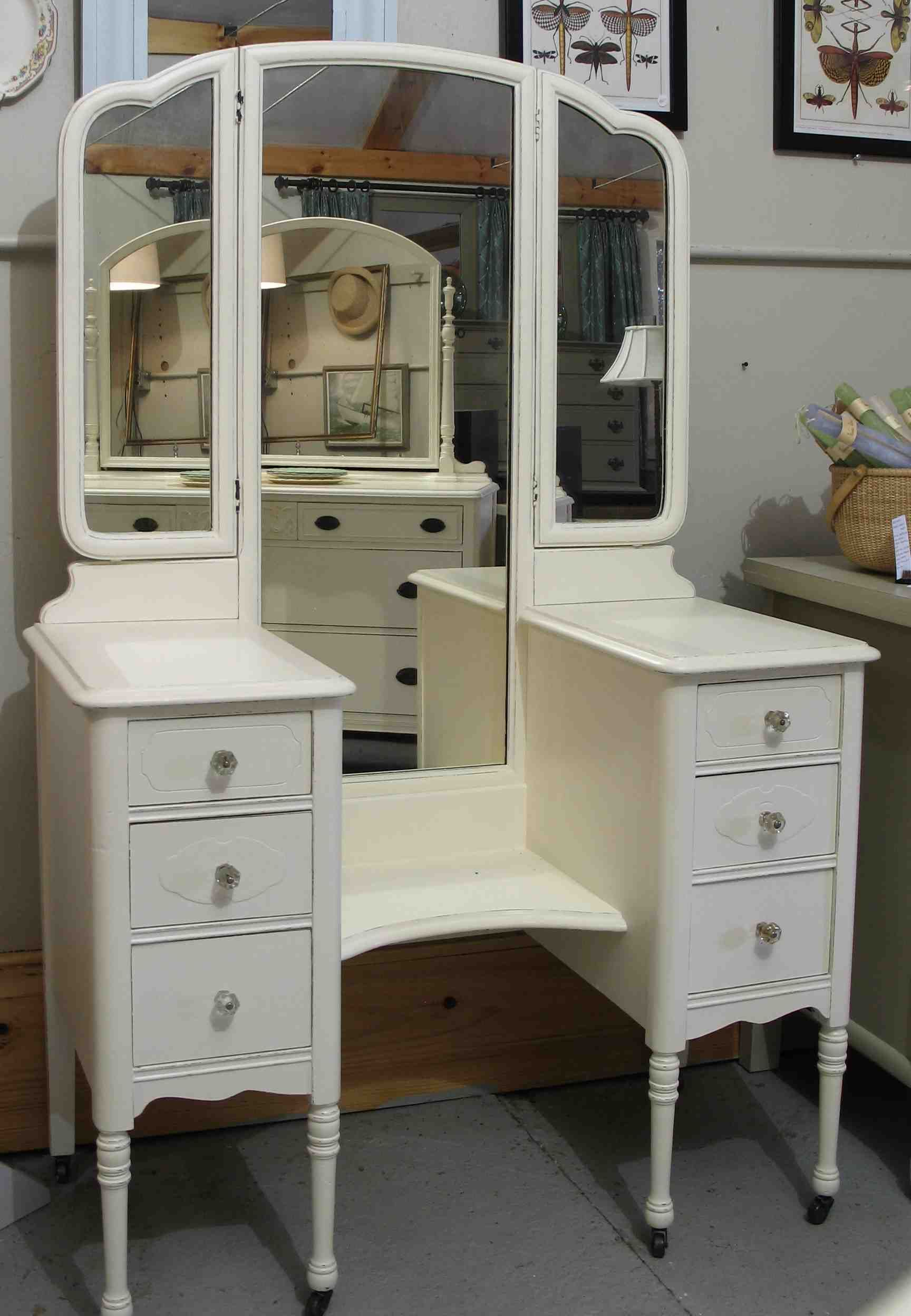 Beautiful Furniture Old And Vintage Wooden Makeup Vanity Table  With 3 Fold Mirror Set And Shelves Between Double Drawer Stand With Wheels Painted With White U2026