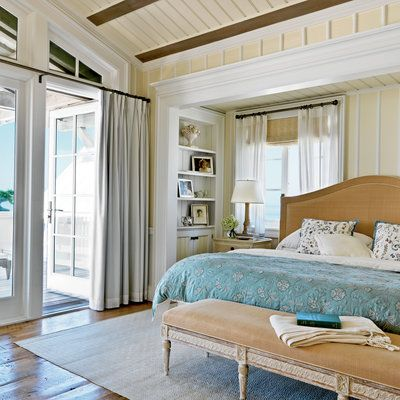 Sweeping views of the Gulf are what you'll see from this Seaside, Florida, master bedroom. The partially shaded deck beyond provides the perfect vantage point. Inside, vaulted ceilings provide a breezy touch and pine floors evoke an earthy feel.