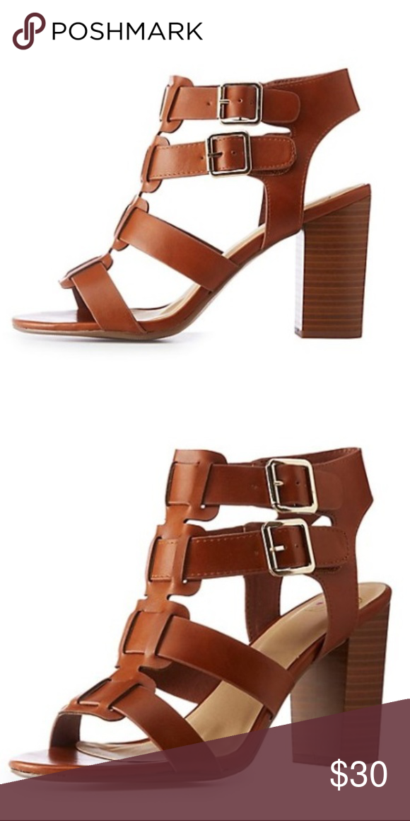 80f1f14312b Faux Leather Camel Buckle Sandals Faux leather shapes these faux stacked block  heel sandals. Cut