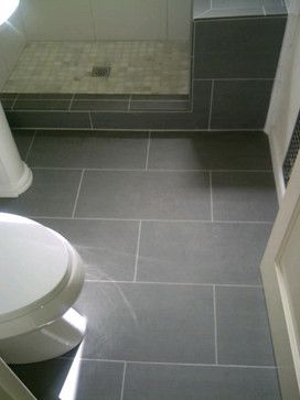 12x24 Porcelain Grey Tiles Love I Know This Is The Tone Of Tile Colour That Dan Loves And I Love This Shape Traditional Bathroom Grey Tiles Grey Flooring