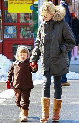 big coat, skinny legs, big boots. oh, and cute kid.