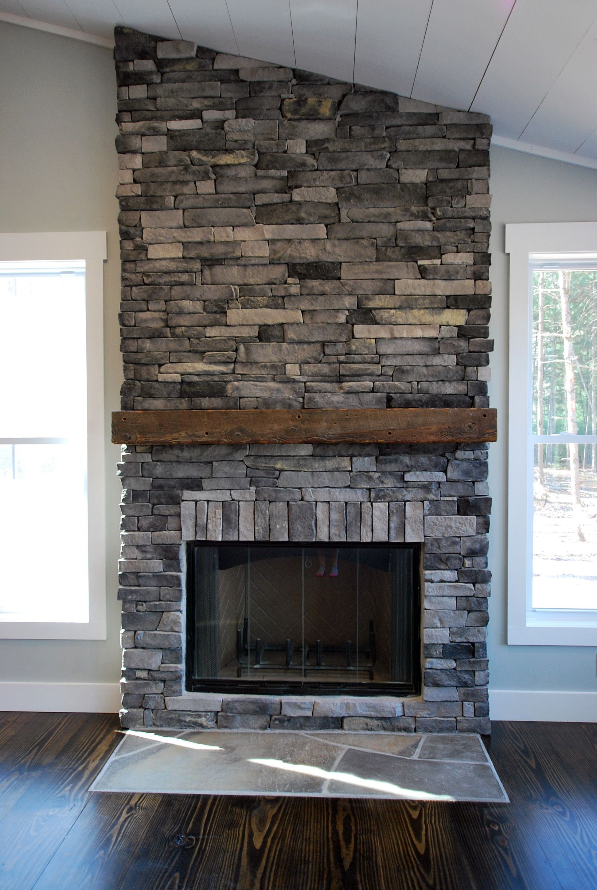 Farmhouse 45 #fireplace has Kingsford Gray Ledgestone with Salvaged Mantel.   Stacked stone ...