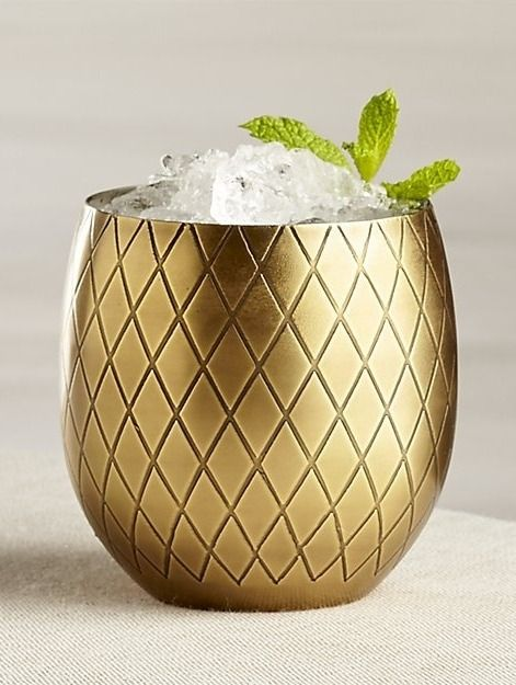 Etched by hand and finished with antique gold, this fun-loving stainless steel glass resembles a pineapple, saying aloha to all kinds of summertime luau concoctions.