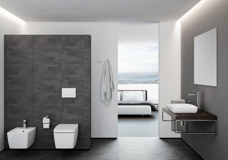 Salle de bain moderne avec un meuble suspendu et un carrelage mural - salle de bain meuble noir