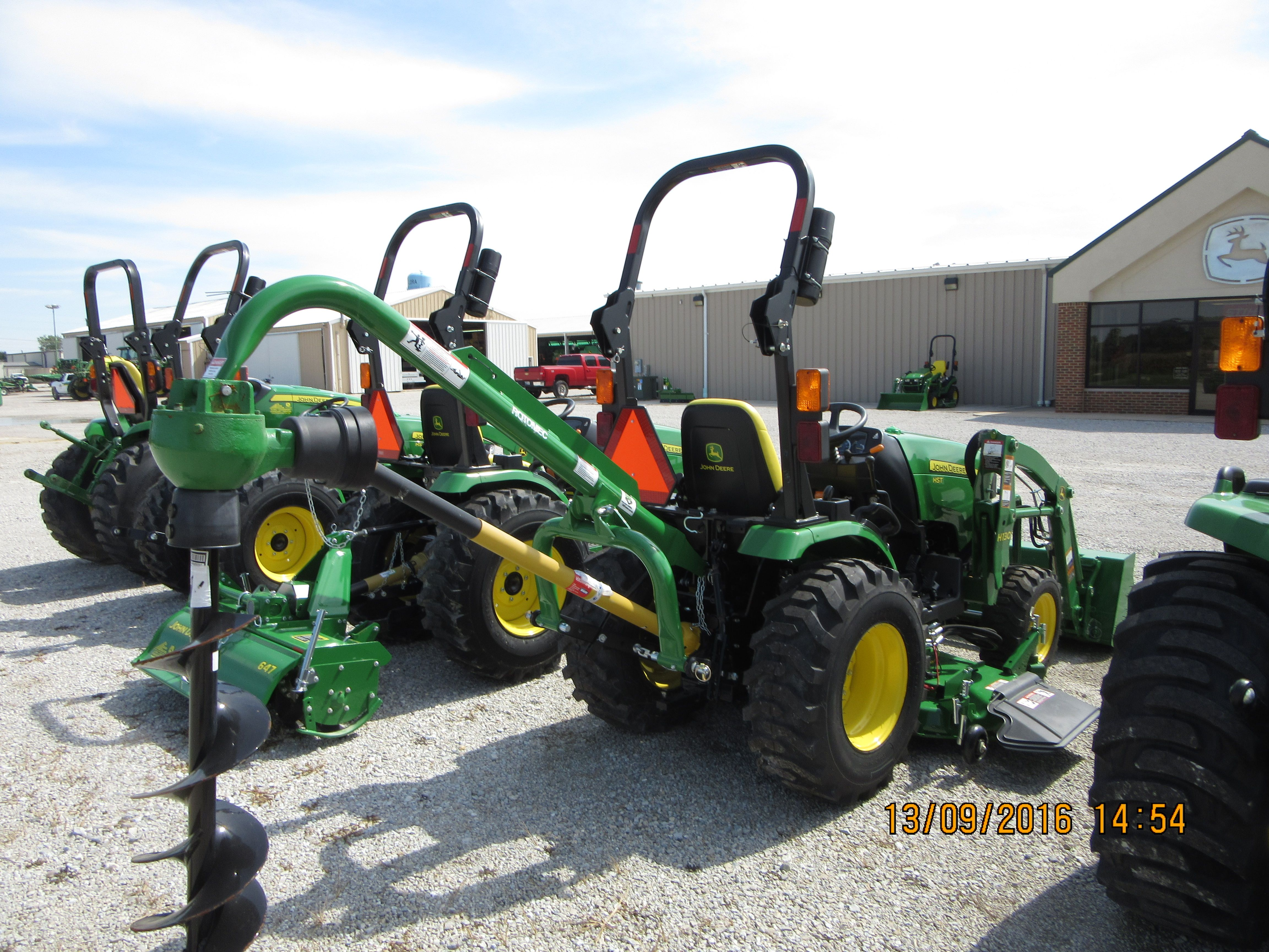 John Deere 2025r Equipped With Frontier Post Hole Digger
