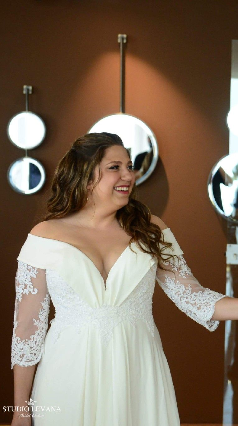 Real bride in a plus size wedding gown with off shoulder sleeves ...