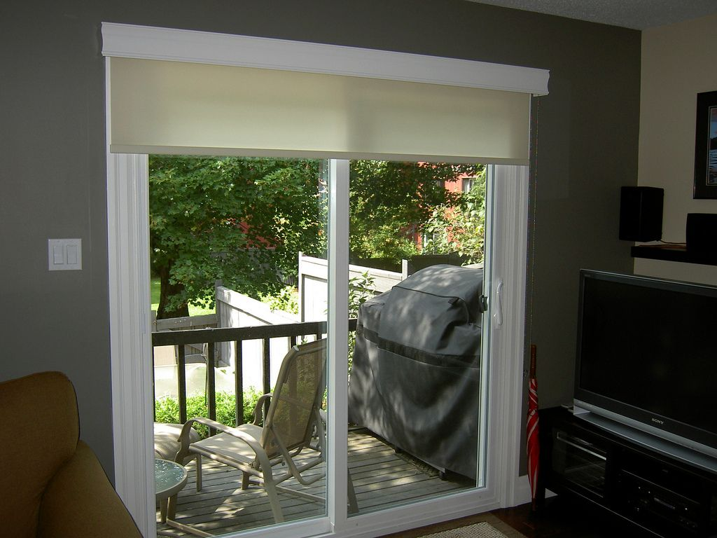 Roller shade on a patio door flickr photo sharing for Backyard sliding door