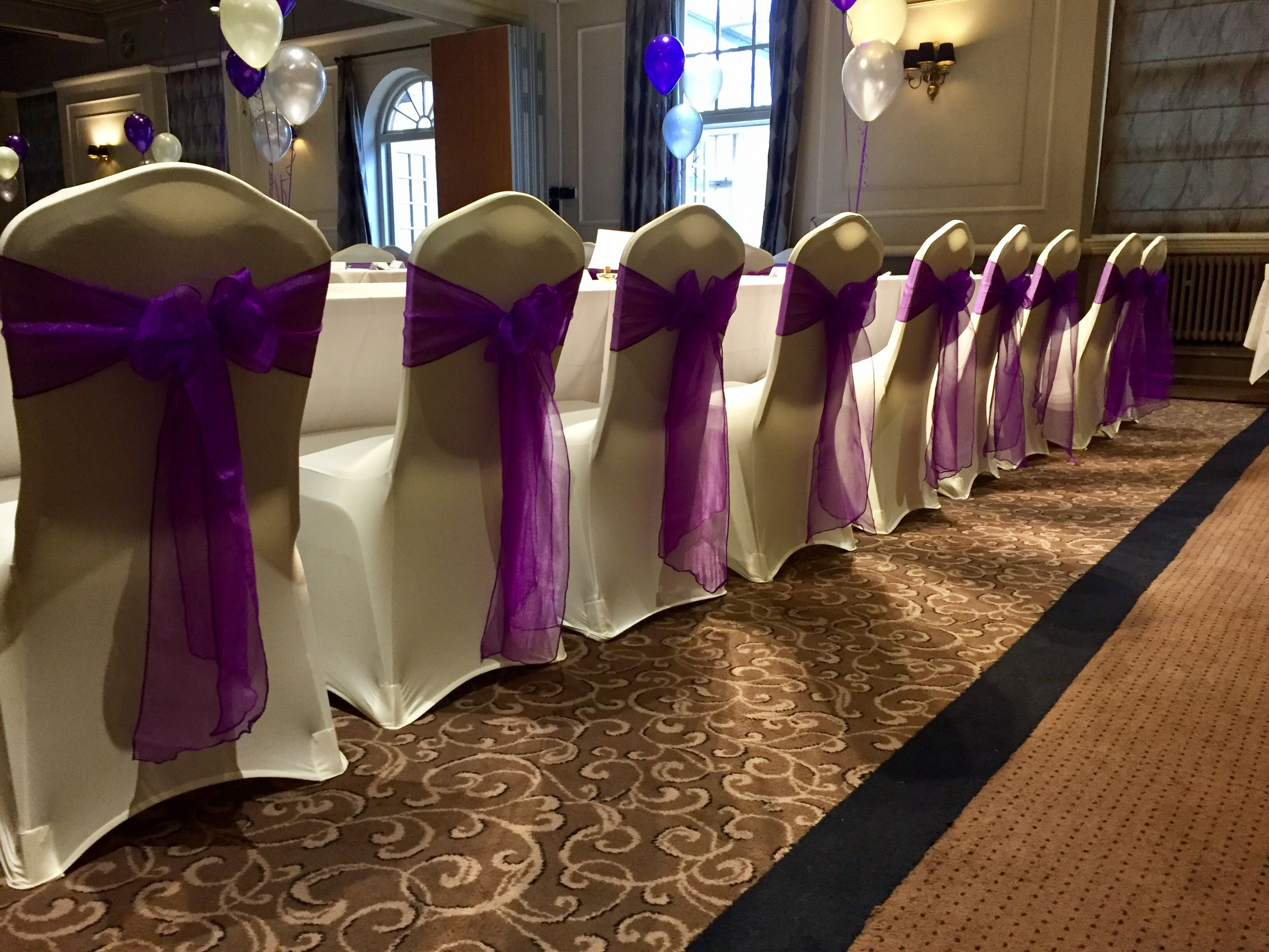 Ivory with Cadbury purple sashes at The Manor Hotel