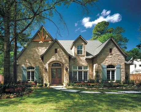 An arched stone entry, blue shutters and rustic wood trim. Timeless ...