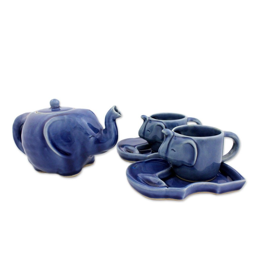 This handmade creation is offered in partnership with NOVICA, in association with National Geographic. Shaped of ceramic, a sleek elephant becomes a teapot by Duangkamol. Matching mugs feature trunks for handles, and plates are shaped like pachyderms in silhouette in a tea set that remind of Southeast Asia. Product Features: Color: Blue Type: Tea set Material: Celadon ceramic Care instructions: Microwave safe, dishwasher safe Set includes: Teapot, two cups, two plates Teapot: 4.9 inches high x 4