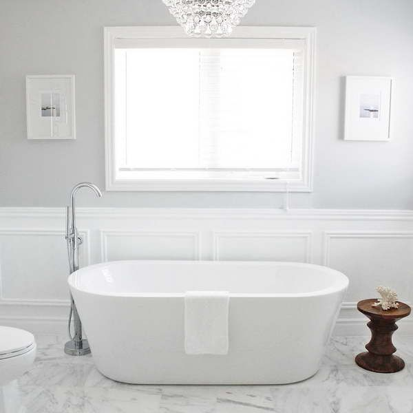 Wainscoting in Bathroom with freestanding tub and marble floor. I like this  combo a lot