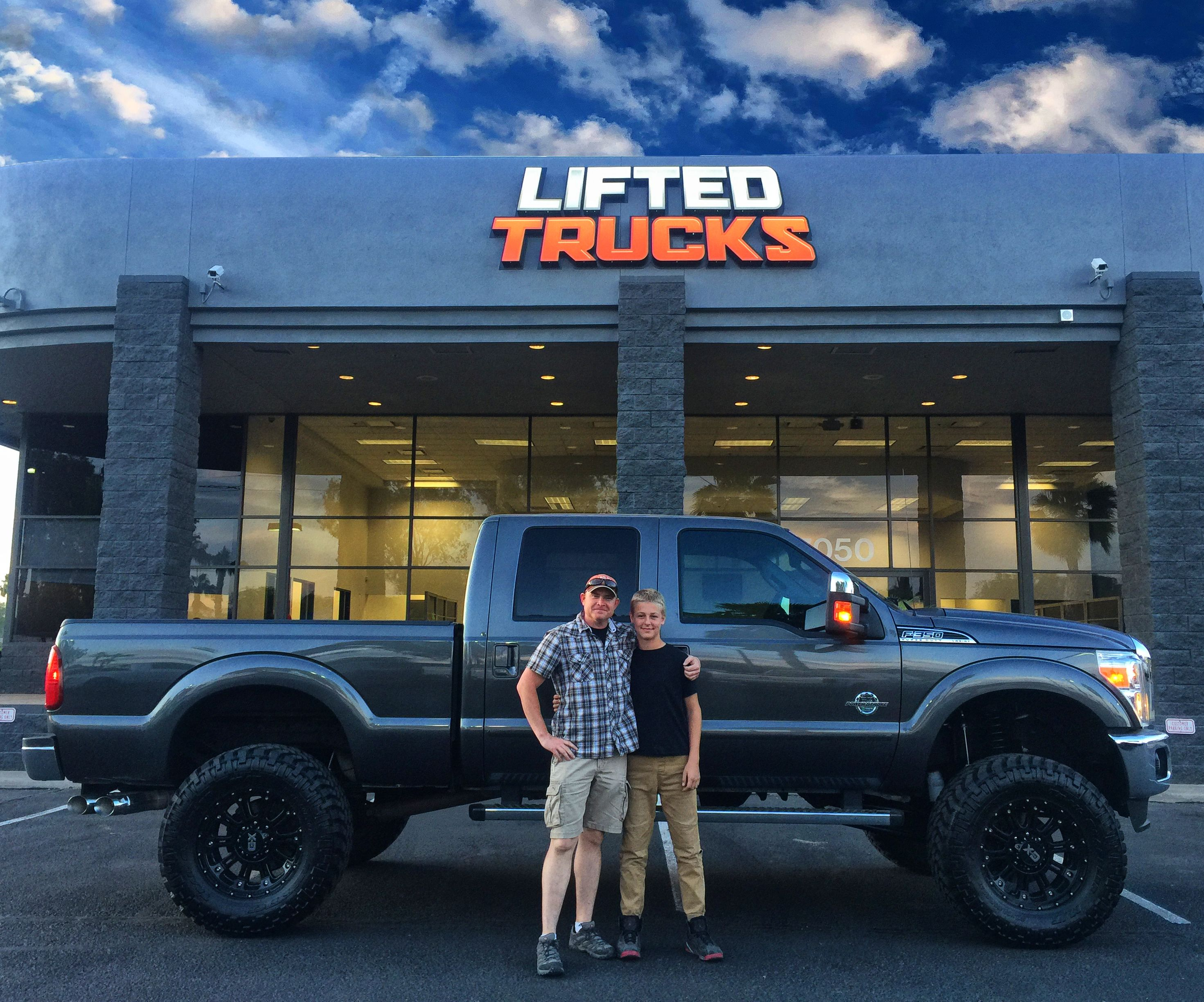 Father And Son With Their New Super Duty From Lifted Trucks