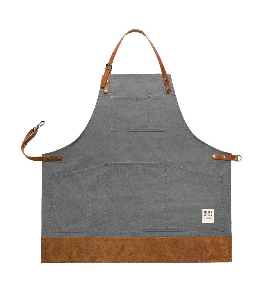 The grey cotton on this apron is done in an appropriately goop grey, so it's no surprise that we were immediately drawn to it. It's outfitted with adjustable le