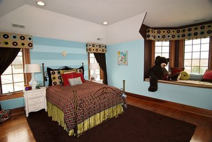 Adorable Childs Bedroom With A Window