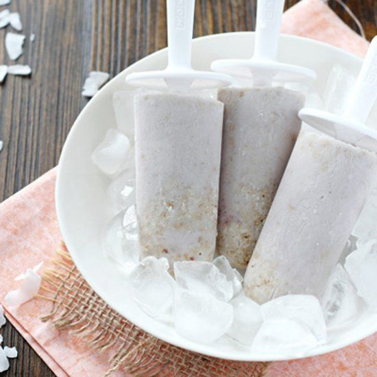 Raspberry coconut tart popsicles. Made with coconut milk, raspberry preserves and graham cracker crumbs!