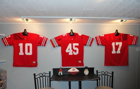 0ab5737e5 Ohio State Buckeyes football jerseys hanging on wall with JerseyGenius™