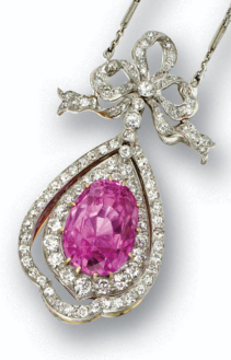 Pink Sapphire and diamond pendant-necklace, circa 1910. The oval pink sapphire weighing 16.91 carats, set as the swing centre of a pendant of conforming shape surmounted by a bow, set throughout with old European-cut and single-cut diamonds, mounted in platinum and gold, supported on a platinum chain set at intervals with 10 marquise-shaped diamonds flanked by old European-cut diamonds, the total diamond weight approximately 4.50 carats. #BelleEpoque #Edwardian #pendant #necklace