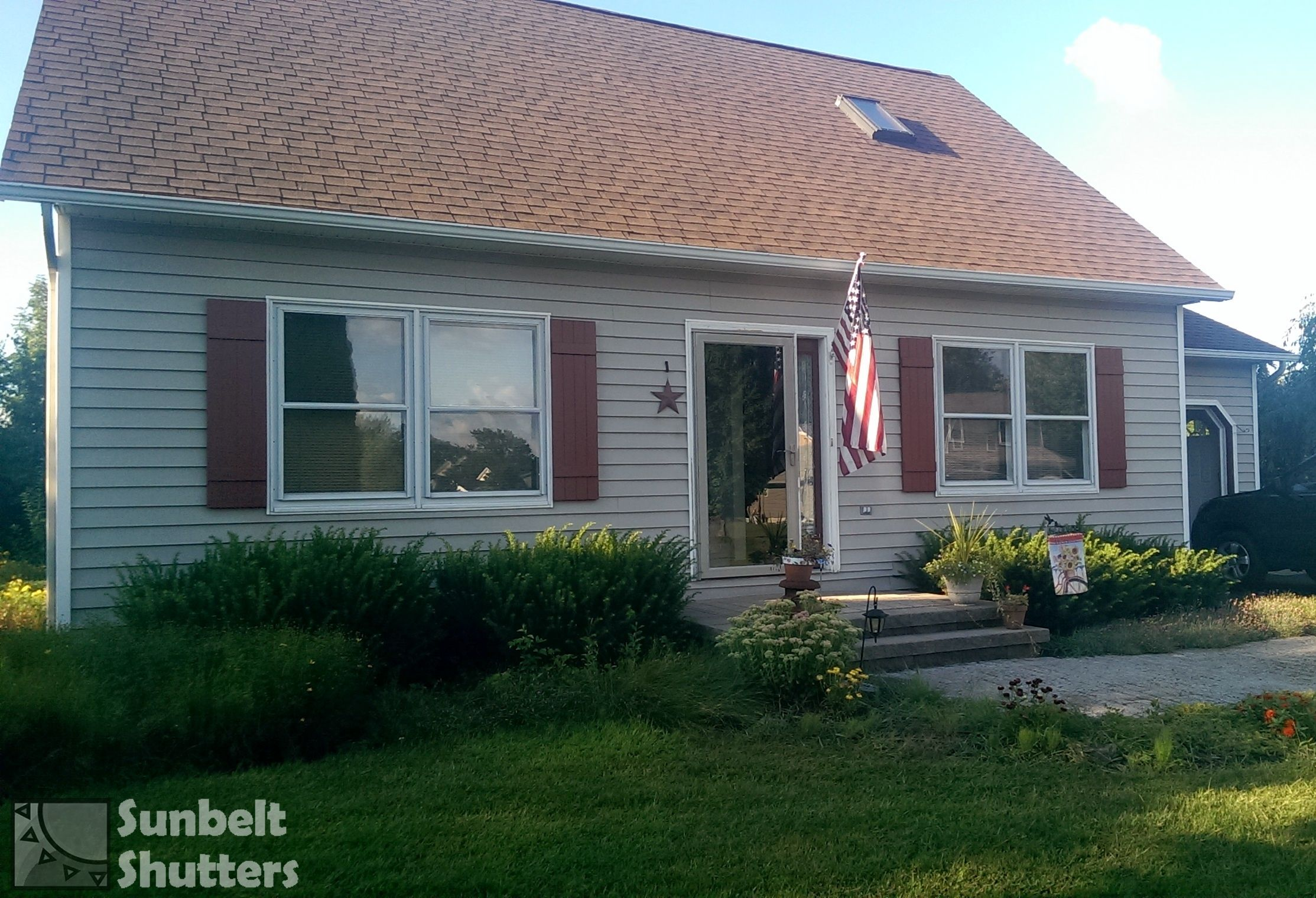 Classic Cape Cod Is Spruced Up With Country Redwood Extira Composite Board And Batten Shutters Manufactured By Shutters Exterior House Colors Window Shutters