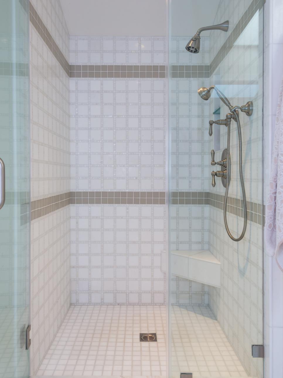 This roomy walkin shower evokes a spalike feel thanks to white