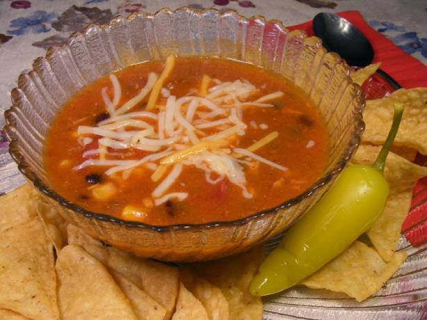Photo: Enchilada Soup  1 cup cooked chicken, diced 3 cups chicken broth (bouillon works just fine) 1 (15 ounce) can black beans, drained 1 (19 ounce) can enchilada sauce  1 (14 1/2 ounce) can diced tomatoes 1 (10 3/4 ounce) can cream of chicken soup 1/2 cup onion, diced 1/2 cup green pepper, diced 1 (10 ounce) package frozen corn 1 tablespoon oil 1 teaspoon salt Directions:  In large soup pot, sauté onion and green pepper in oil over medium-high. Heat until soft, about 5 minutes. Add all…