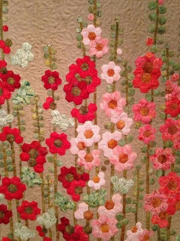 These Hexie Flowers Make The Perfect Wall Hanging Fabric Flowers Hexies Applique English Paper Piecing Quilts Hexagon Quilt Pattern Hexie Quilts Patterns