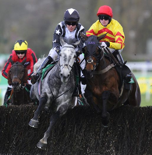 Andrew Tinkler riding Quentin Collonges (2L) on their way to winning The bet365Gold Cup Steeple Chase from Same Difference (R) at Sandown racecourse on April 27, 2013 in Esher, England. (Photo by Alan Crowhurst/Getty Images)
