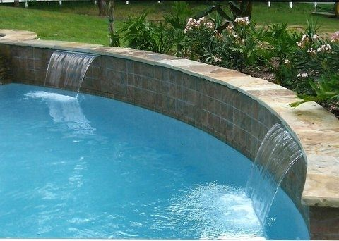 The Pool Was A Classic Oblong Shape And Also Contained A Raised