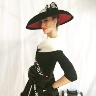 140e4118544 Black Dior brim felt hat with red under brim and black and white flower  accents