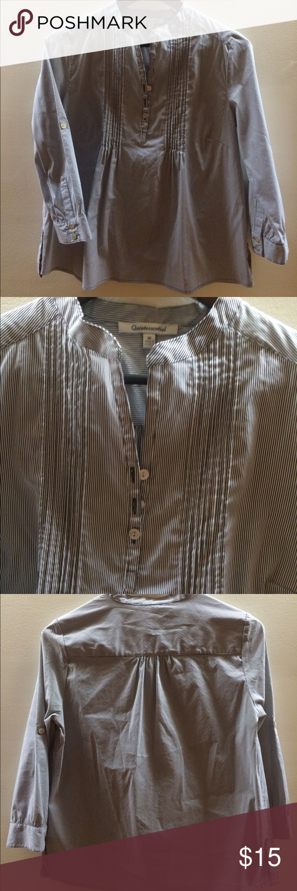 3/4 sleeve blouse with pleats at front Super flattering work shirt! Lots of details like the roll-up sleeve tabs and tab at bottom sides of shirt. quintessential Tops Blouses