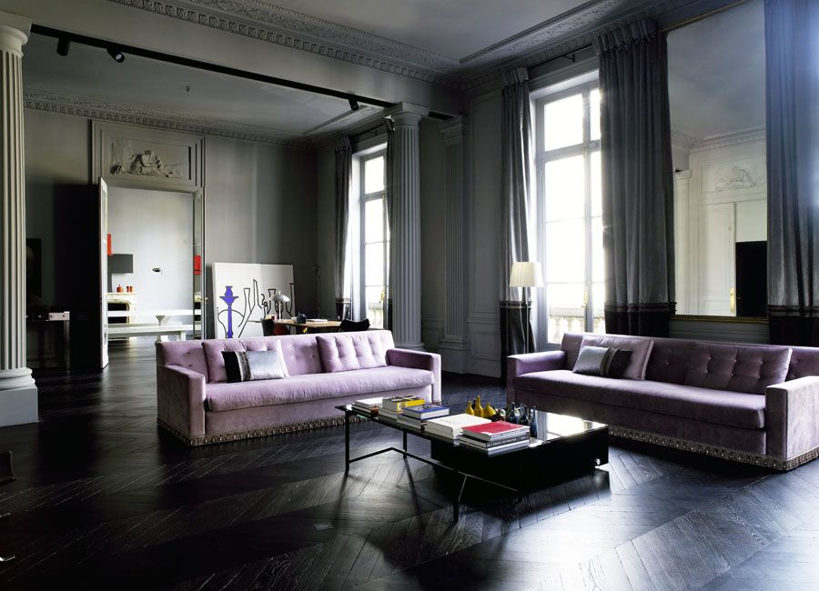 Living room with columns, gray walls, lavender sofas and interesting wood floors. http://cococozy.com
