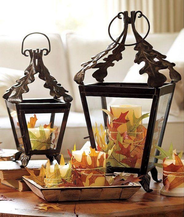 Pour créer une atmosphère chaleureuse et romantique à l'extérieur ou bien à l'intérieur, optez pour la magnifique décoration automnale avec des lanternes et