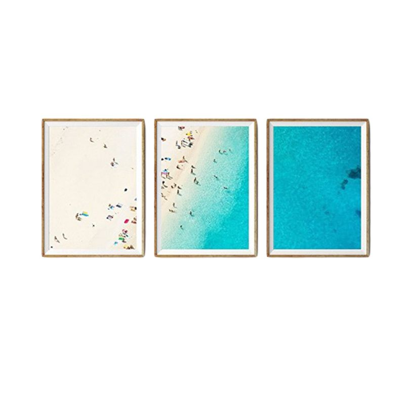 """Liz Lipkin, Homepolish - """"This triptych packs a big, bright visual punch that will really pop on a crisp white wall. I love that the prints are part of a limited edition from an independent artisan in Australia! If you long for surf and sand, these prints deliver the beach right to your door."""""""