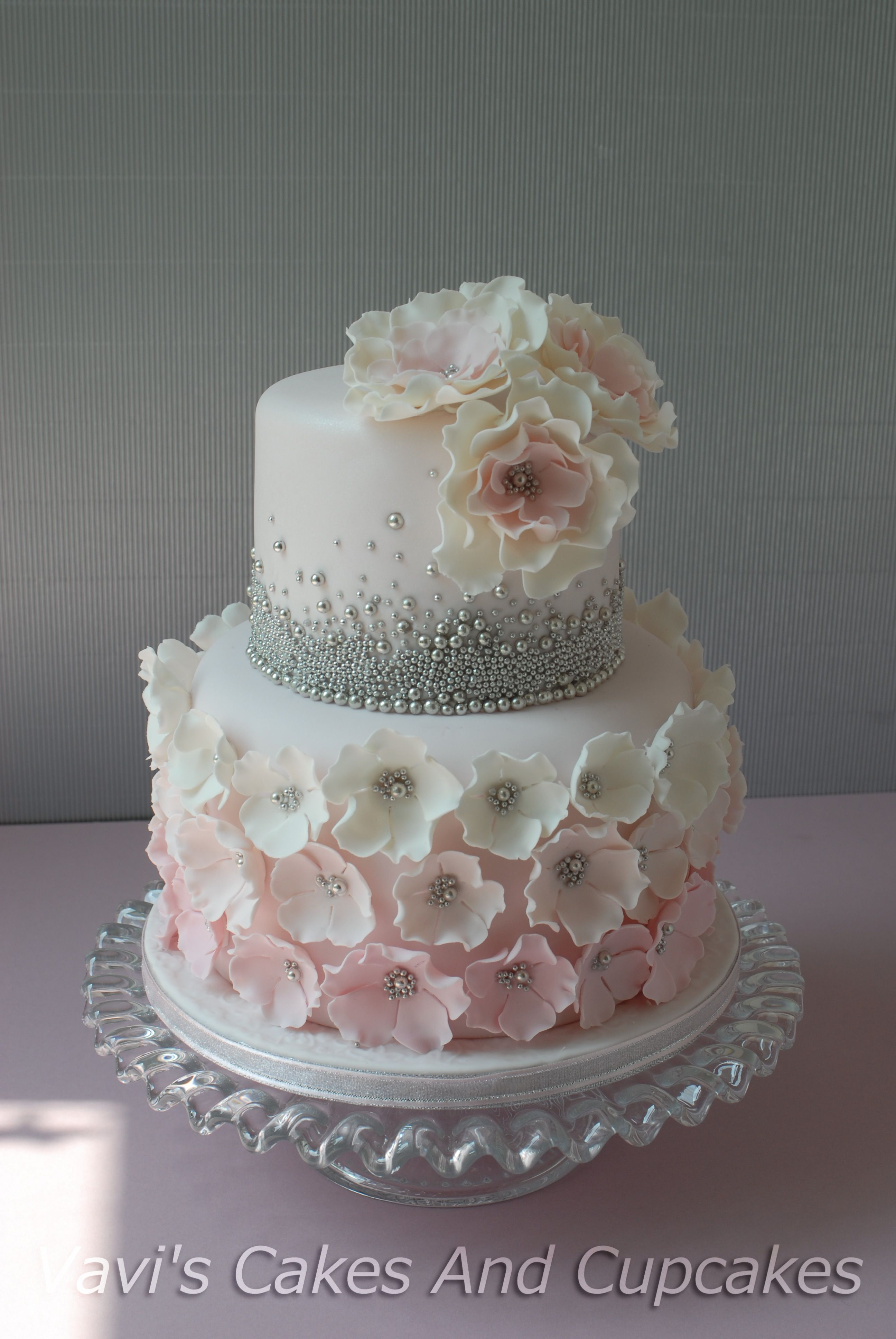 I love the top tier without the flowers Maybe a 50 on top with your
