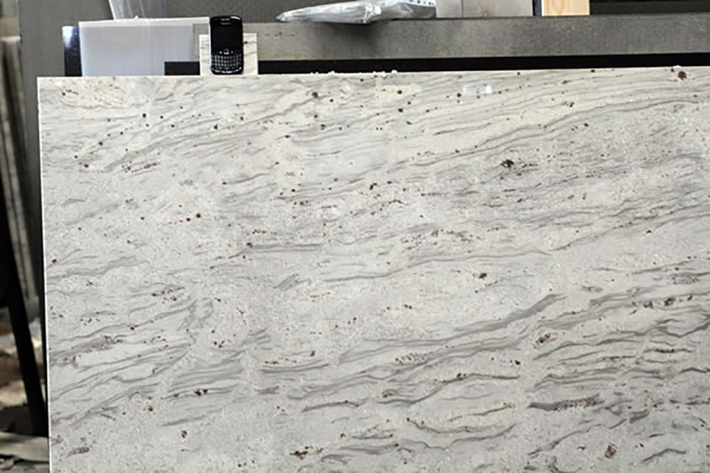 River White Granite From India Is Very Similar To Kasmir White But With  More Cranberry Spotting And Grey River Patterns