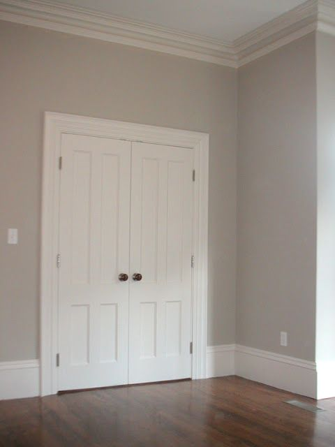 Light grey walls white baseboards dark knobs for Light neutral paint colors