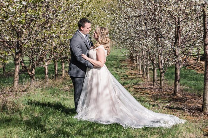 lace train wedding gown, loose bridal hair inspiration, wedding bride hair from chic Rustic Barn wedding at Bluemont Vineyard by Photography by Marirosa