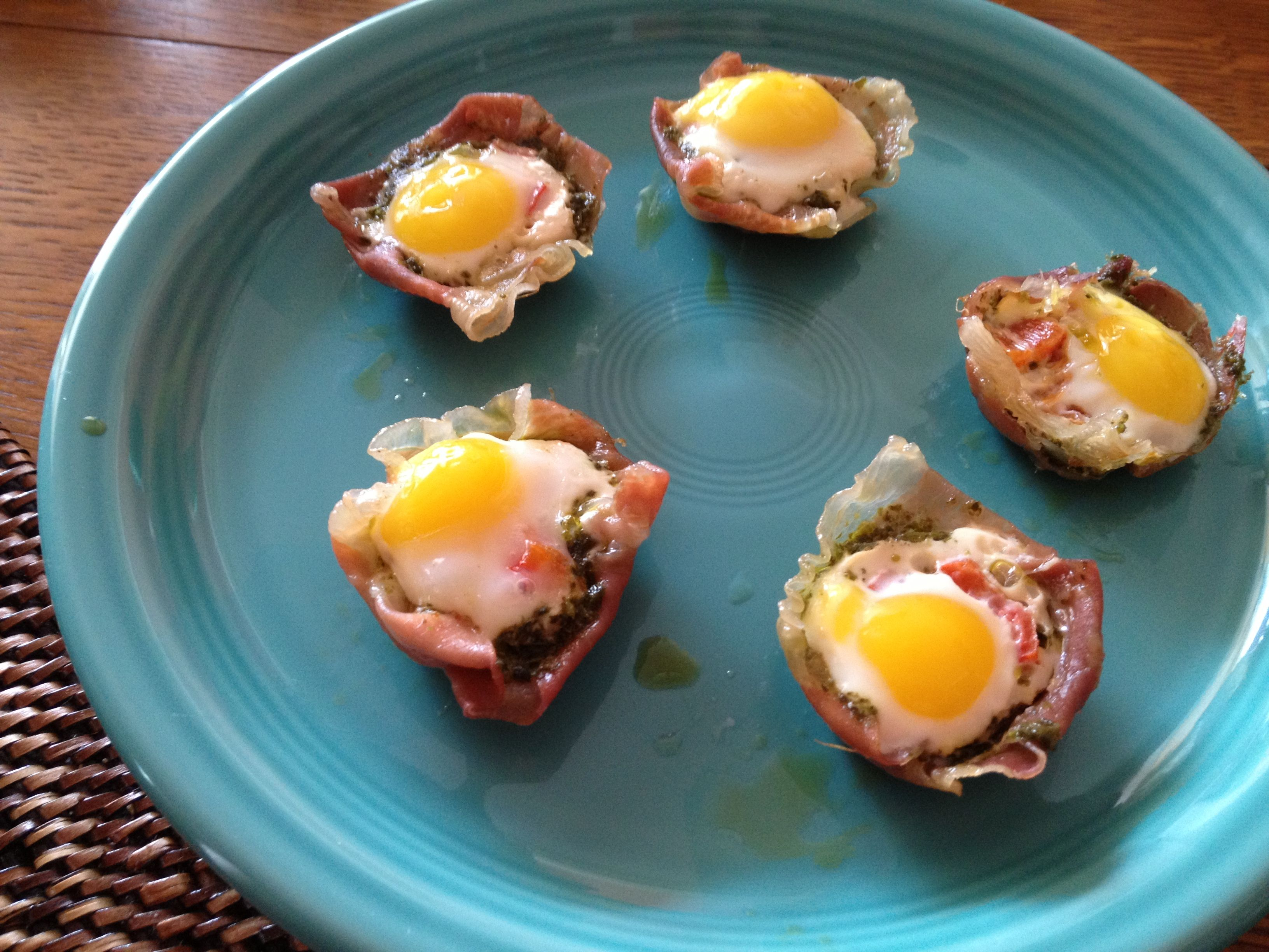 Prosciutto cups with pesto, roasted red pepper and quail eggs.  Bake in a mini muffin pan @ 350 X 15 min.