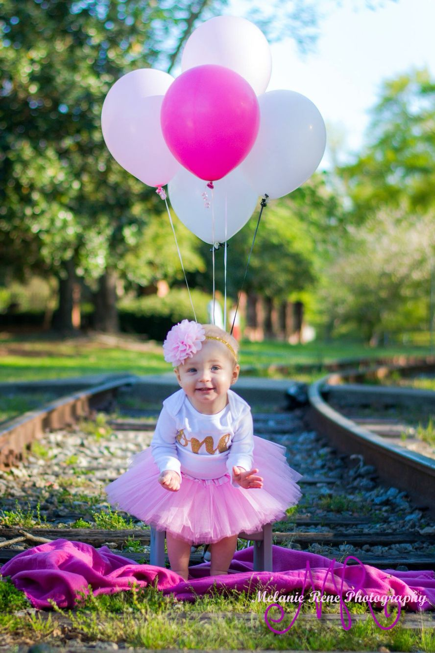 One year old photo shoot girl with balloons