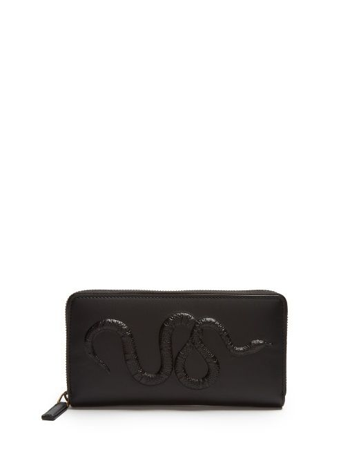 32766ac972c GUCCI Snake-embossed leather wallet.  gucci  wallet Gucci Wallet