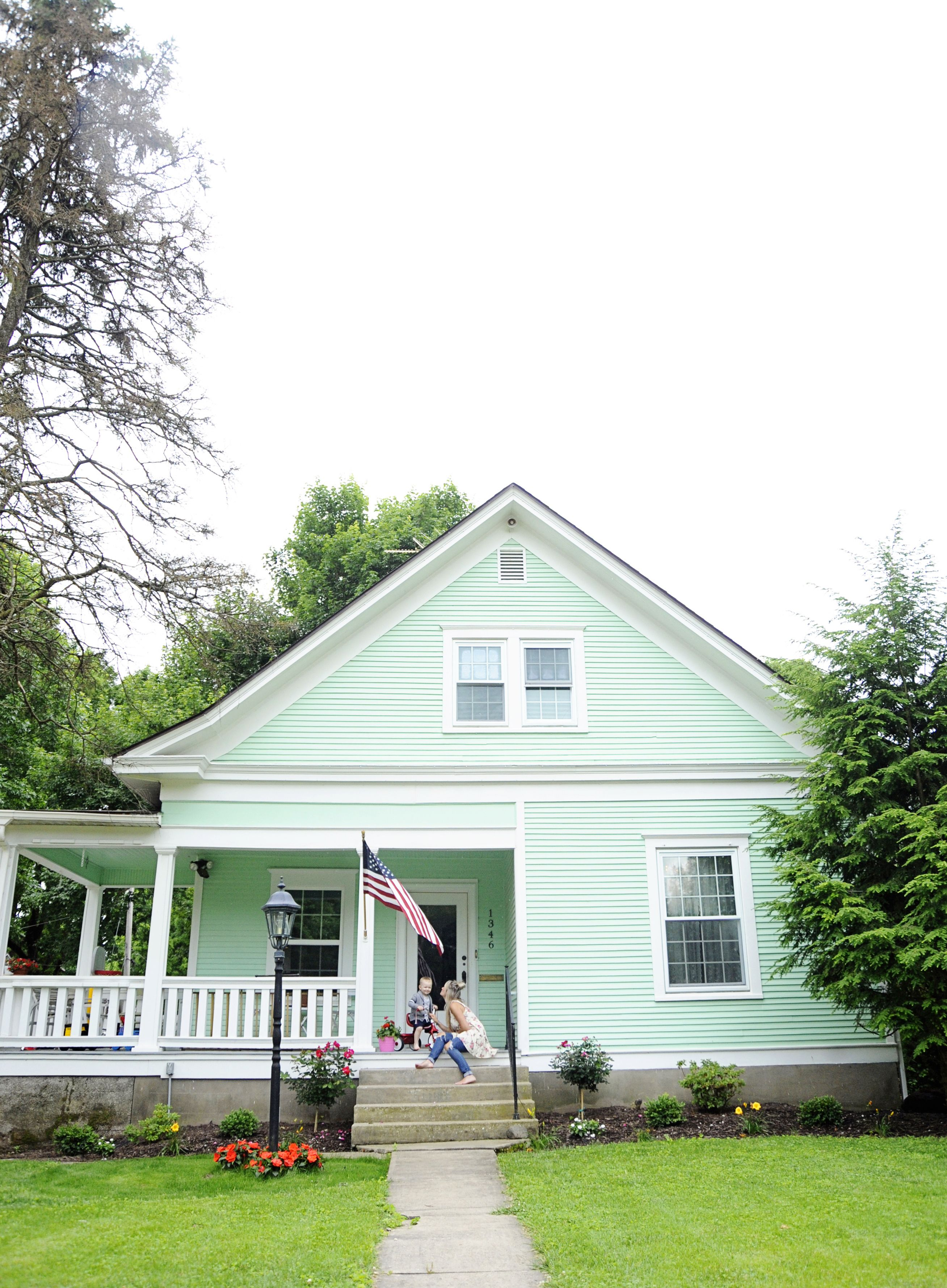 At Home With Lindsey Key Clouse In Springfield Missouri A Beautiful Mess Green House Exterior Green Exterior House Colors House Exterior
